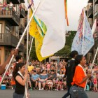 A large crowd gathers to watch the Fiesta Flambeau Parade.