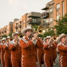 UT's marching band plays during the Fiesta Flambeau Parade.