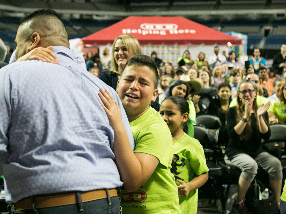 Jacob, 12, cries in pride of his father Albert Trevino (left) who one a $10,000 prize at the H-E-B Slim Down Showdown.
