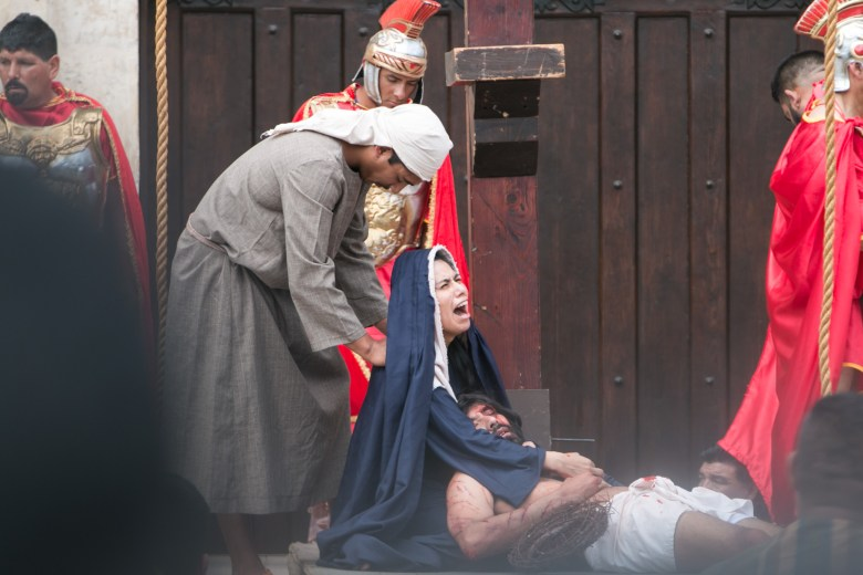 Actors portraying Mary and Jesus participate in the Passion of Christ Re-enactment and Procession at San Fernando Cathedral.
