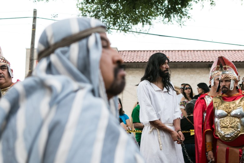 An actor portraying Jesus (center) waits to begin the Passion of Christ Procession.