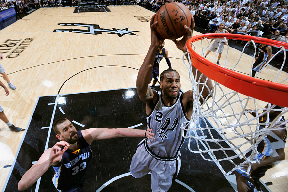 Kawhi Leonard #2 of the San Antonio Spurs goes to the basket against the Memphis Grizzlies in Game One of Round One during the 2017 NBA Playoffs on April 15, 2017 at the AT&T Center in San Antonio, Texas.