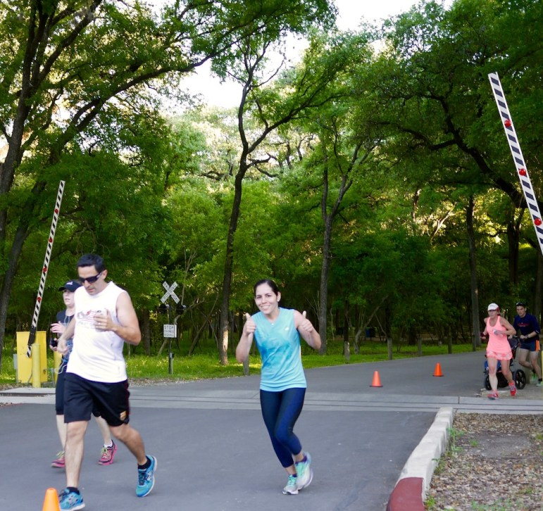 A runner gives the thumbs up sign during a Brak Pak run on April 5. The free event is held every week from April through October at Brackenridge Park. Photo by Noi Mahoney