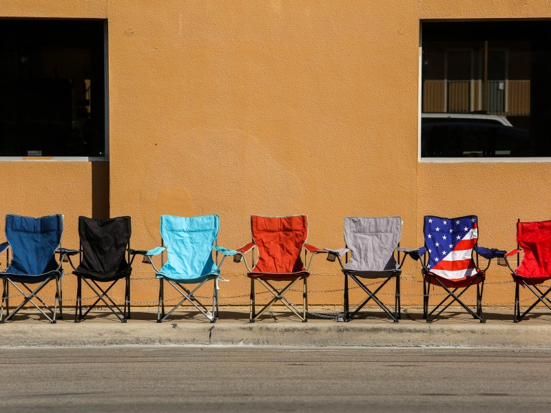 Camping chairs are staged along Broadway Street in preparation for the Battle of Flowers Parade on Friday.