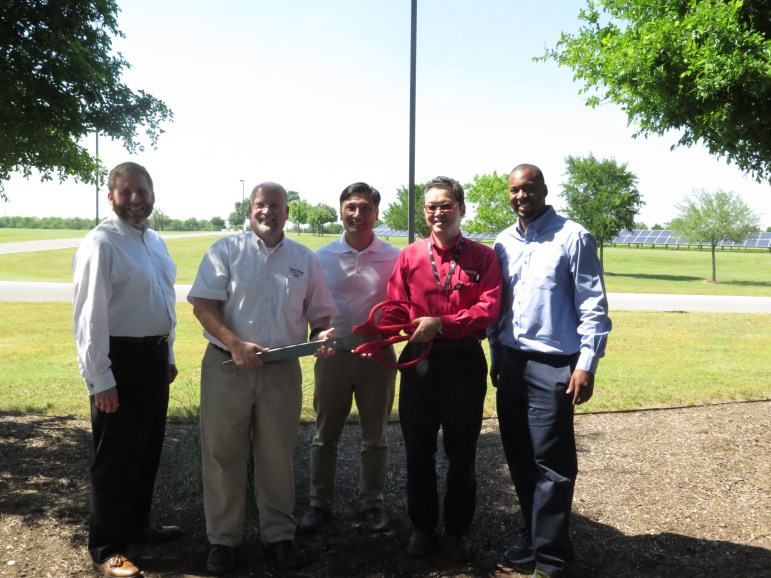 (From left): CPS Energy executive Todd Horsman, Toyota Motors Manufacturing Texas General Manager Rob Franklin, PowerFin Partners President Tuan Pham, Toyota Texas plant President Yoshi Nagatani, and Toyota Texas Plant Engineering Specialist George Anglin pose after cutting the ribbon for the new solar panels.