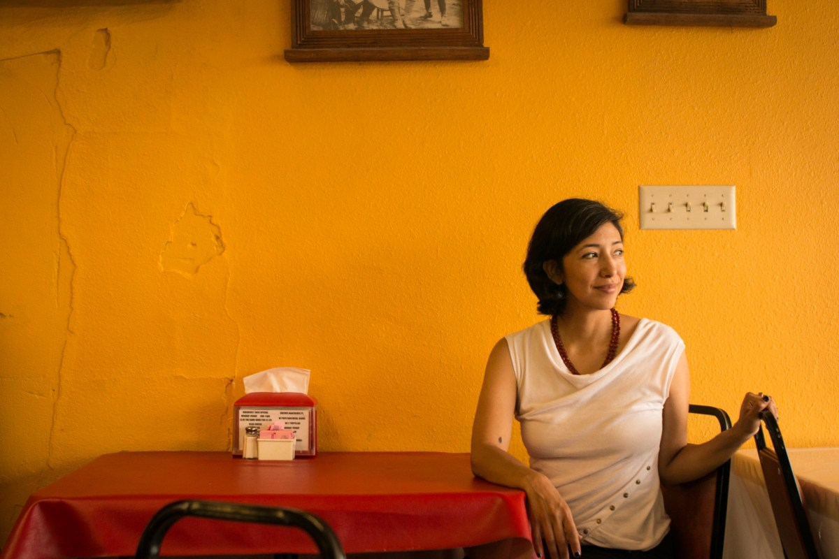 Ana Sandoval sits for a portrait in Chile Tomate & Cebolla Mexican Restaurant.