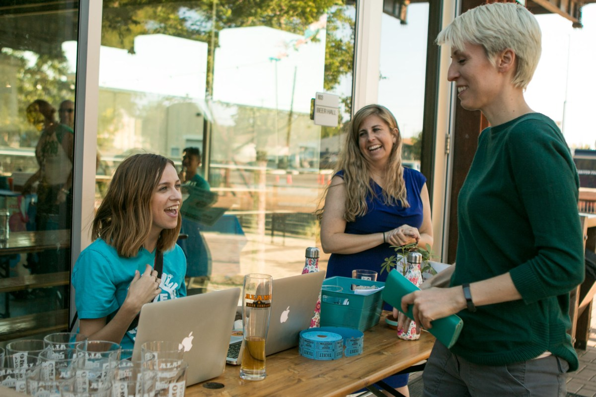 (From left) Mary Kate Hull, Stacy Jones, and Annie Calonico share a laugh at the Give 2020 event at Alamo Beer.