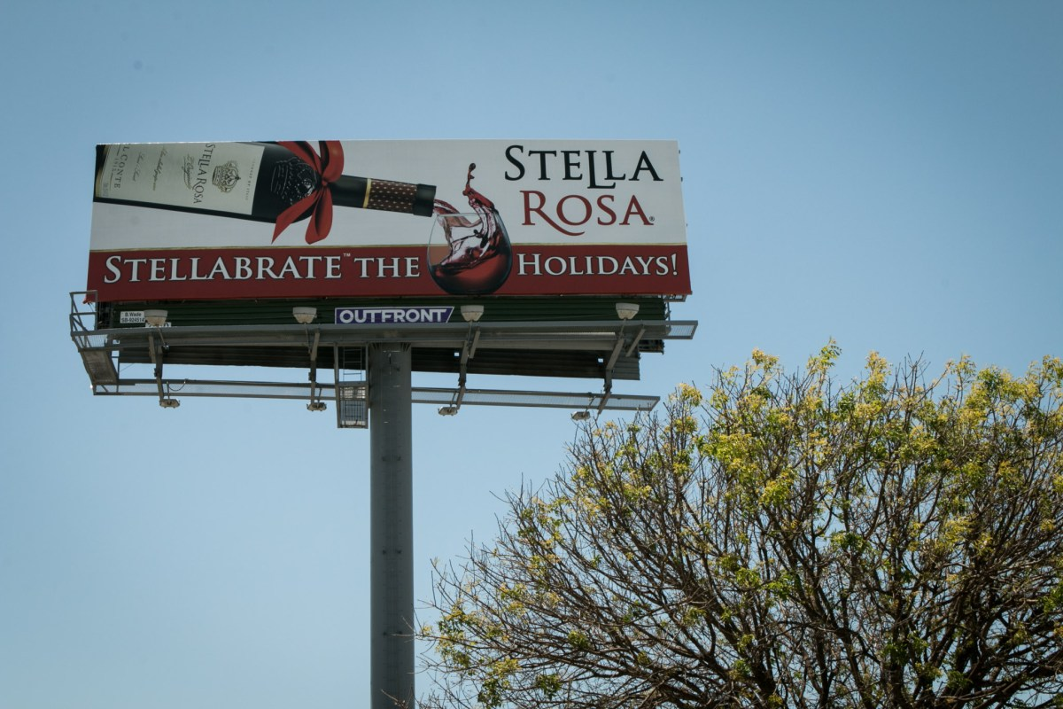 A billboard advertising Stella Rosa is visible from I-35.