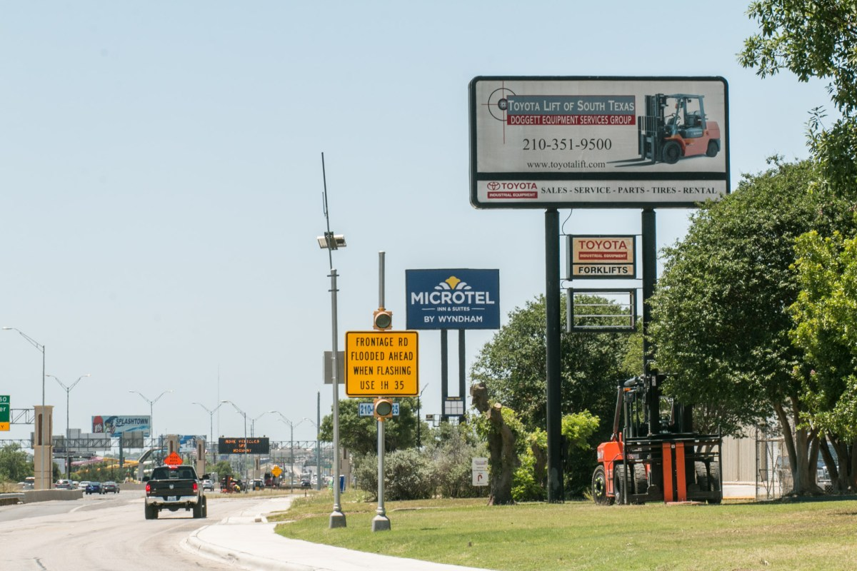 Billboards are visible from I-35.