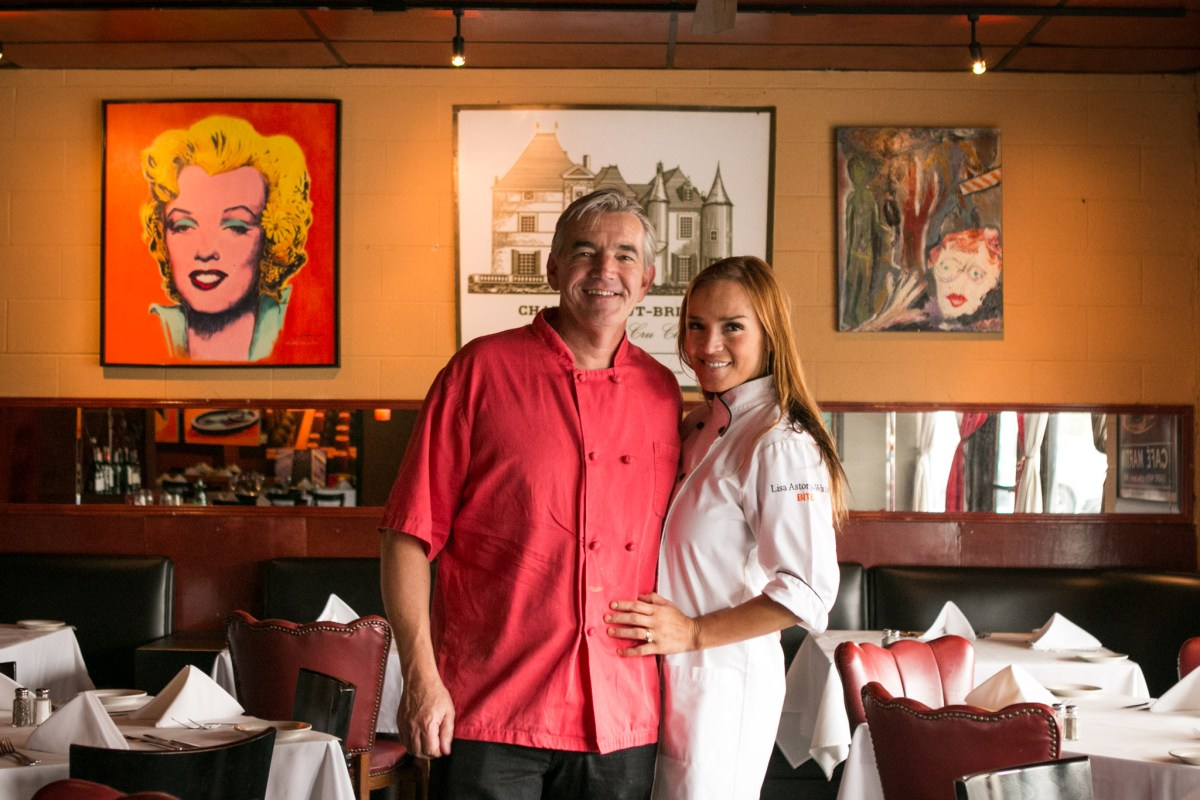 (From left) Damien Watel and Lisa Astorga-Watel stand in the dining area of Bistro Vatel.
