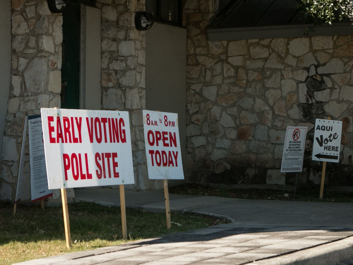 Signs indicate where to vote at the early voting site at Lions Field.