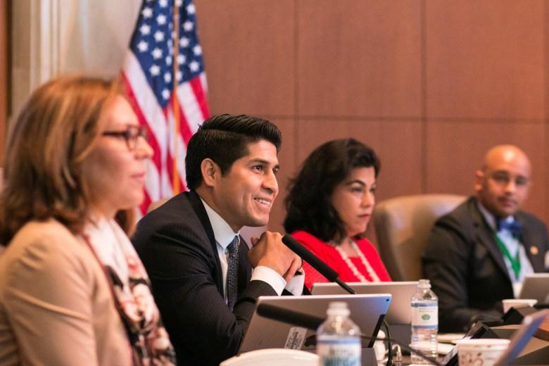 Councilman Rey Saldaña (4) smiles in response to a proposal during City Council.