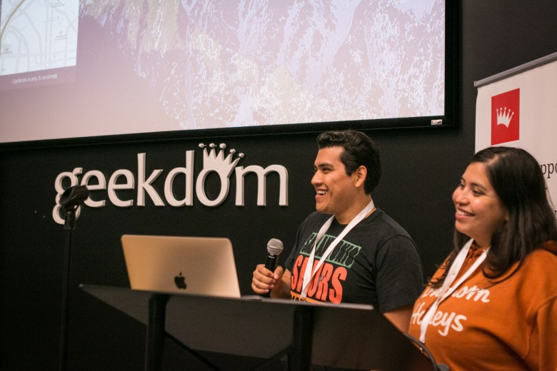 """Ronnie Rocha (left) and Jessica Rocha from team """"Rocket Tier"""" present their project at Codeathon awards."""