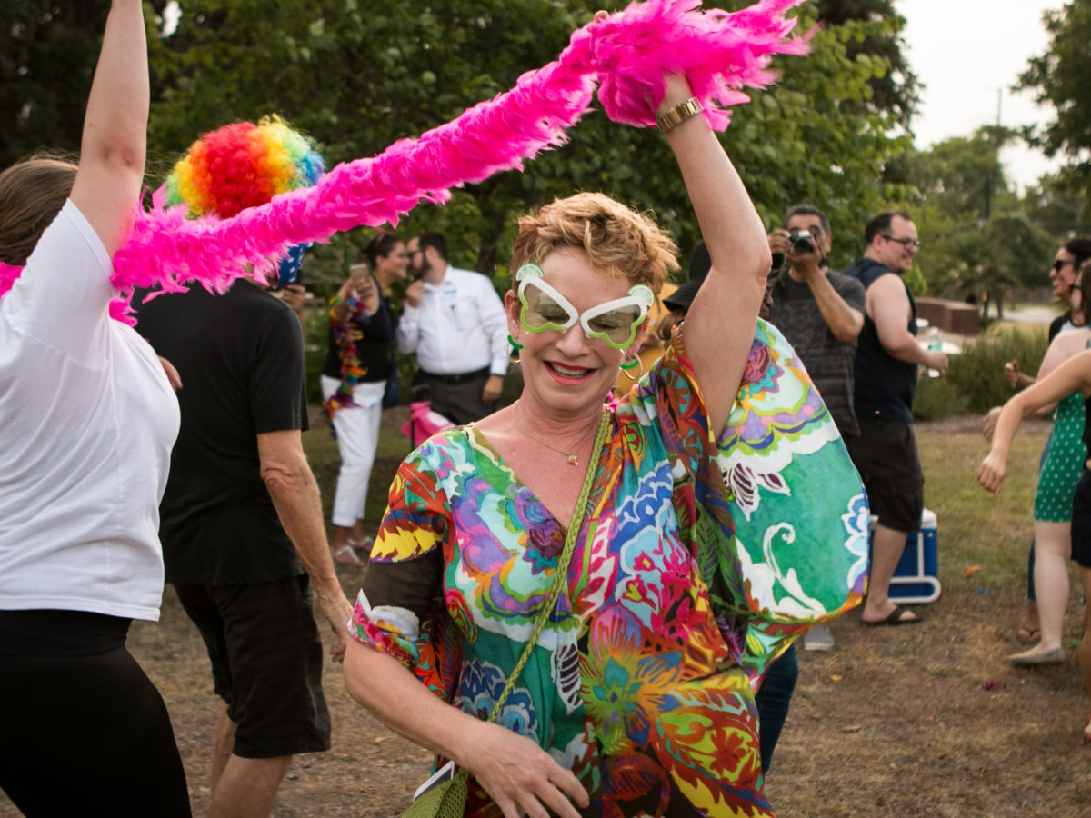 Darlene Kilpatrick dances at the Gay Pride Mob Flash Dance in front of Mayor Ivy Taylors house.