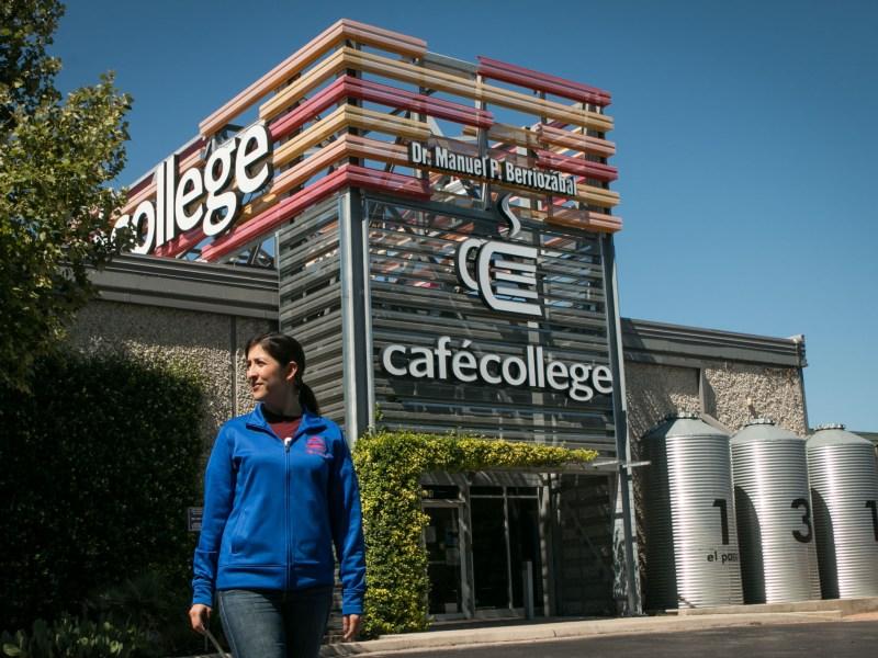 Upgrade Program Director Micaela Rios walks outside of Café College.