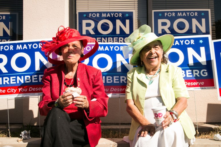 (From left) Rosa Rosales and Angie Garcia enjoy breakfast tacos and coffee outside of Ron Nirenberg's campaign headquarters.