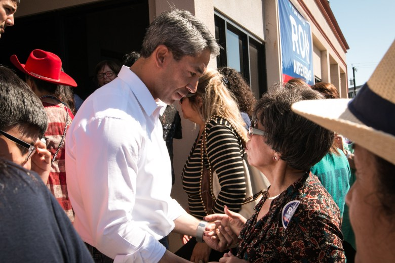 Councilman Ron Nirenberg (D8) speaks with citizens at his campaign headquarters.
