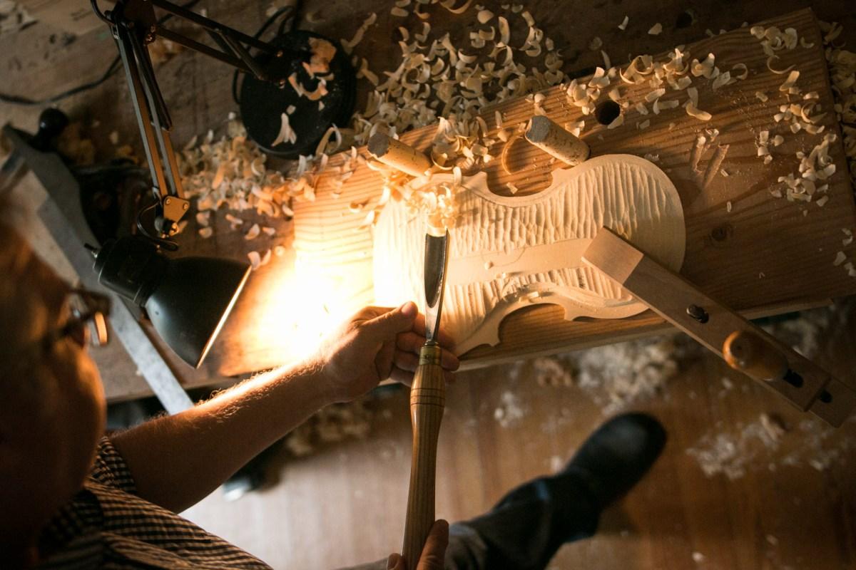 Scott Albert creates a violin in his workshop.
