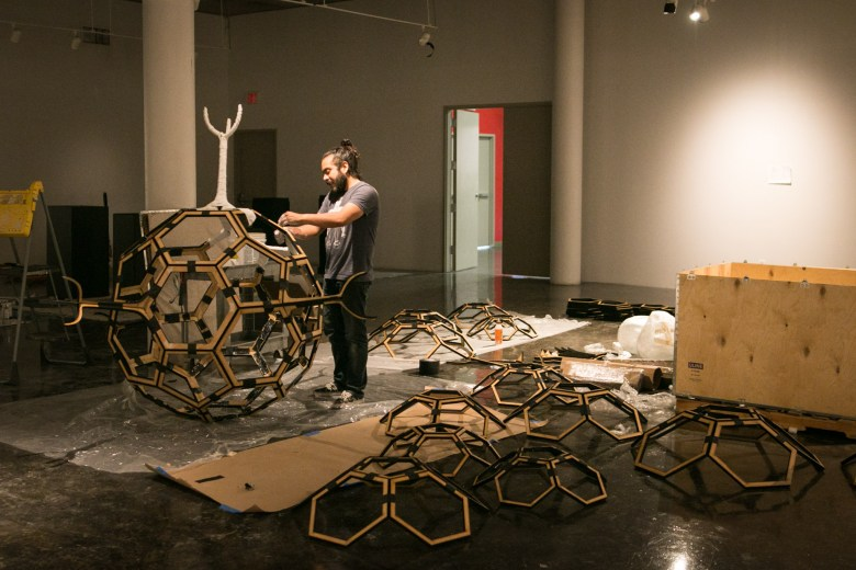 """Mexican artist Victor Pérez-Rul works on a piece for his upcoming exhibition """"The Odds,"""" opening May 19 at the Southwest School of Art."""