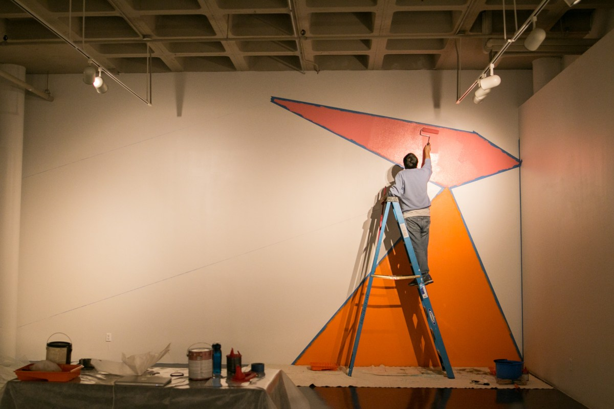 """San Antonian artist Esteban Delgado paints directly onto the wall for his upcoming exhibition """"Plural Forms,"""" opening May 19 at the Southwest School of Art."""