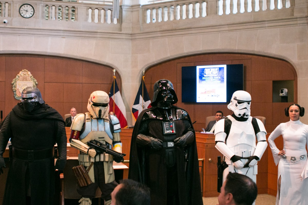 A group dressed in Star Wars costumes stands in front of City Council.