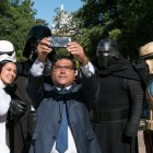 Spectrum News reporter John Salazar poses for a selfie with a group dressed up as characters from Star Wars.