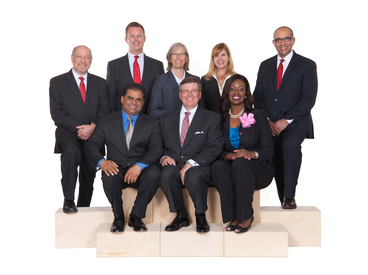 Ft. Bend ISD School Board (bottom, from left) KP George, Jim Rice, secretary Addie Heyliger, (top, from left) Dave Rosenthal, vice president Jason Burdine, Grayle James, president Kristin K. Tassin, and ________.