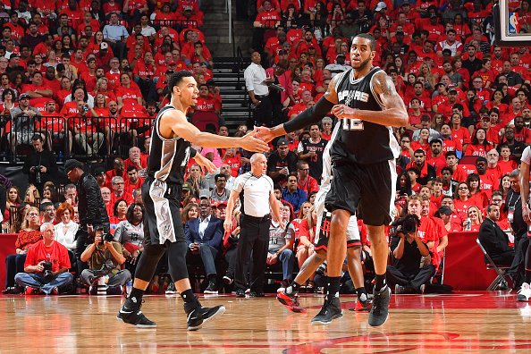LaMarcus Aldridge #12 and Danny Green #14 of the San Antonio Spurs high five each other during the game against the Houston Rockets during Game Six of the Western Conference Semifinals of the 2017 NBA Playoffs on May 11, 2017 at the Toyota Center in Houston.