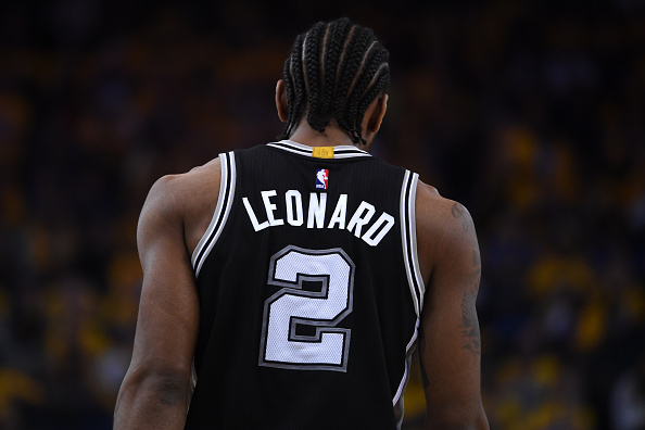 Kawhi Leonard #2 of the San Antonio Spurs stands on the court during Game One of the NBA Western Conference Finals against the Golden State Warriors at ORACLE Arena on May 14, 2017 in Oakland, California.