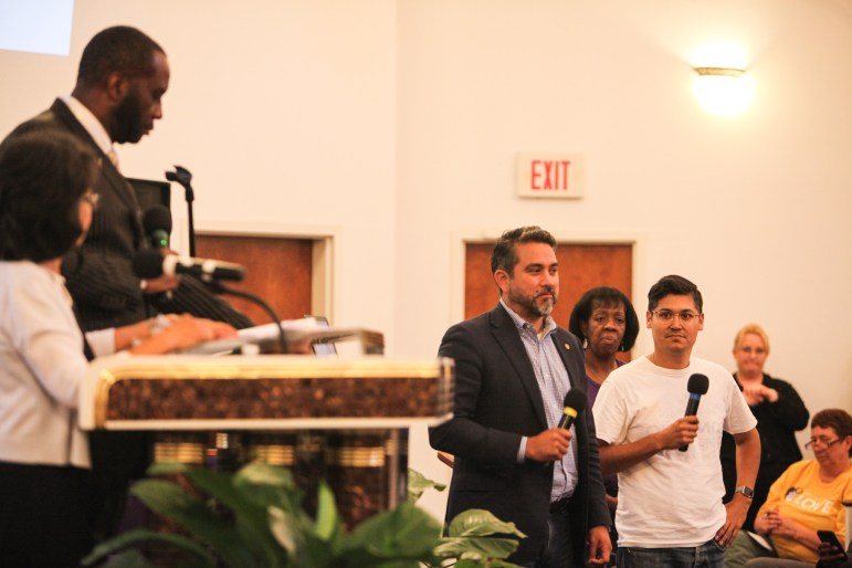 """Councilman Roberto Treviño (D1, center) speaks at the COPS/Metro Alliance's """"get out the vote"""" rally. He will face Michael Montaño (right) on the June 10 ballot."""