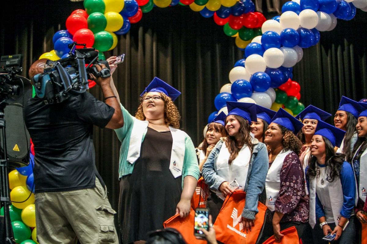 South San Antonio Student Jada Gonzalez leads a group selfie at the surprise graduation celebration.