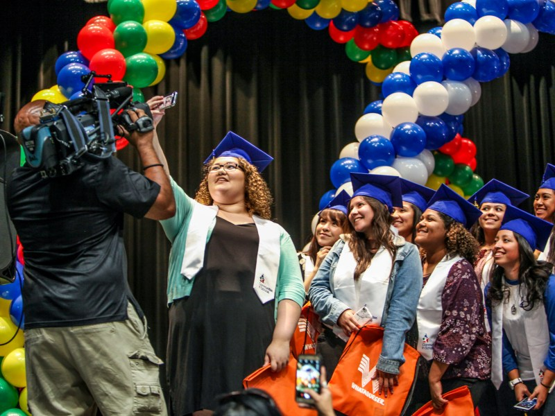 South San Antonio Student Jada Gonzalez leads a group selfie at the surprise graduation celebration.