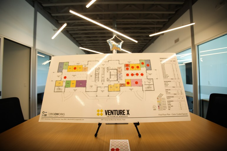 Several bids on spaces are made at the Venture X grand opening.