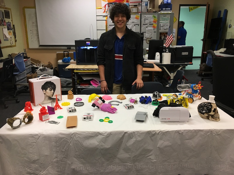 Justin Cantu, a sophomore at the School of Science and Technology with various items printed with the school's 3D printer.