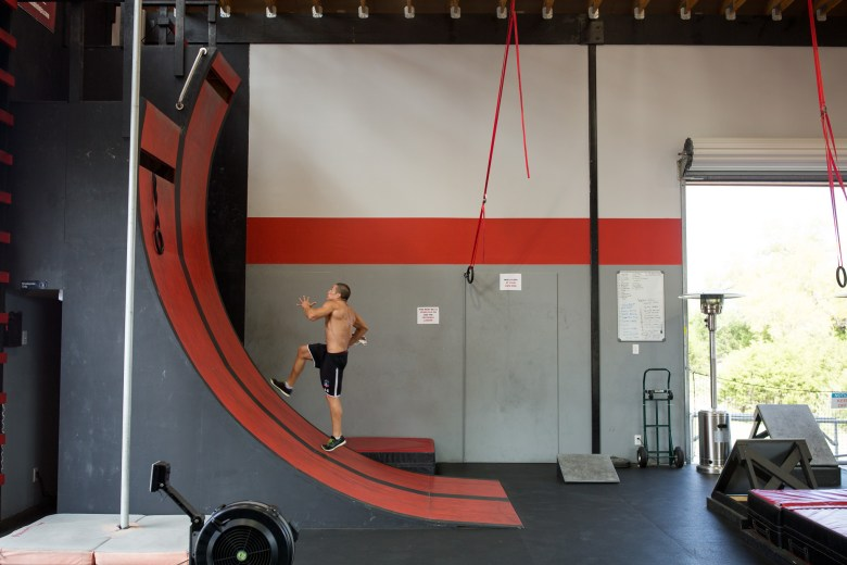Lufe Torres sprints up a ramp simulated to those seen on American Ninja Warrior at Power Park Fitness in Spring Branch, Texas.