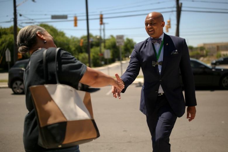 Councilman Alan Warrick (D2) meets his constituent Priscilla Franklin after her recent vote at Sam Houston High School in San Antonio's Eastside.