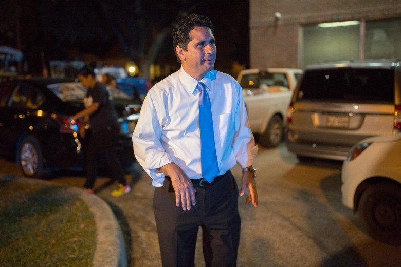Mayoral candidate Manuel Medina passes outside his campaign headquarters after receiving only 15.13% of the vote.