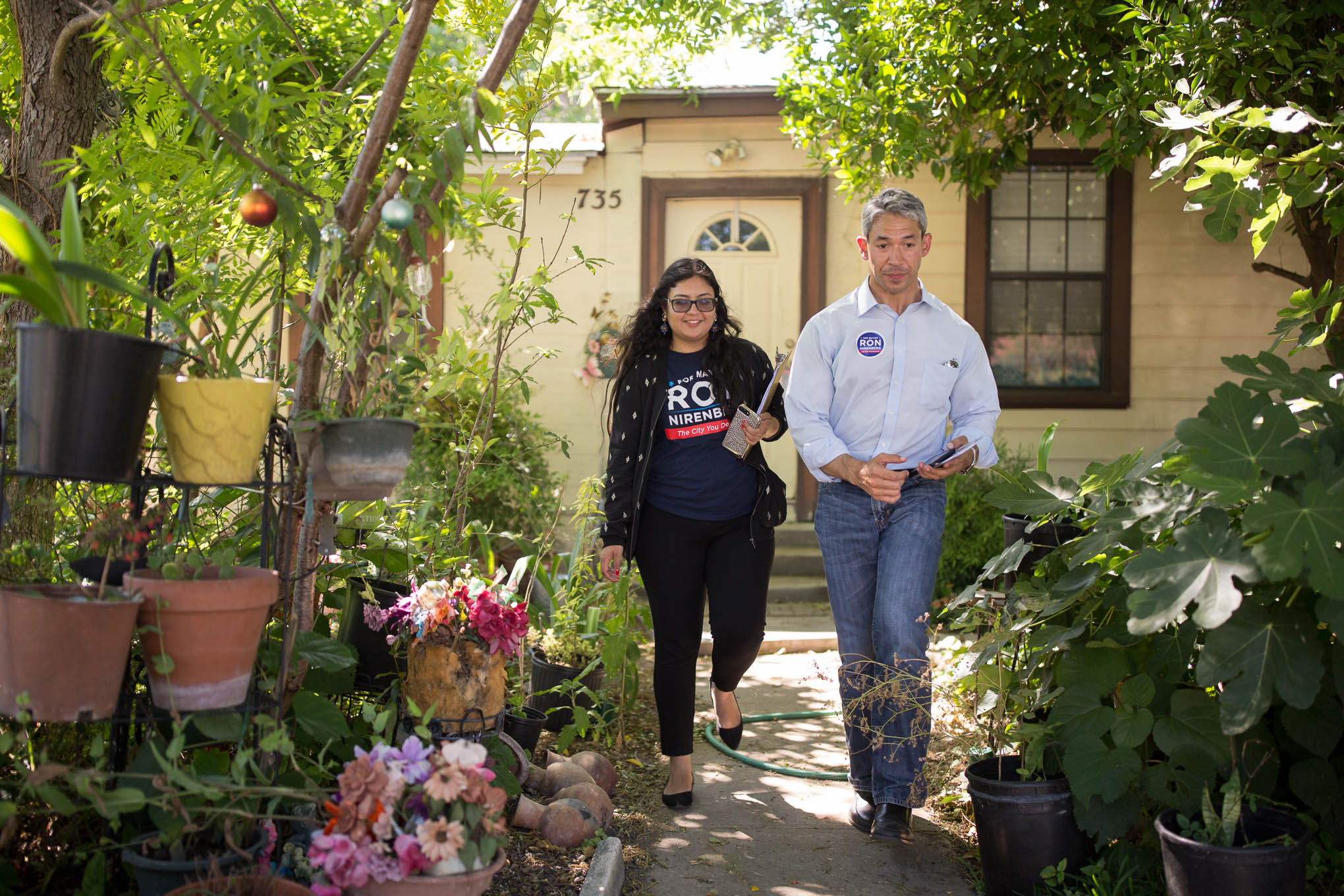 Mayor candidate Ron Nirenberg walks through a neighborhood seeking votes on election day with Deputy Campaign Manager Juany Torres.