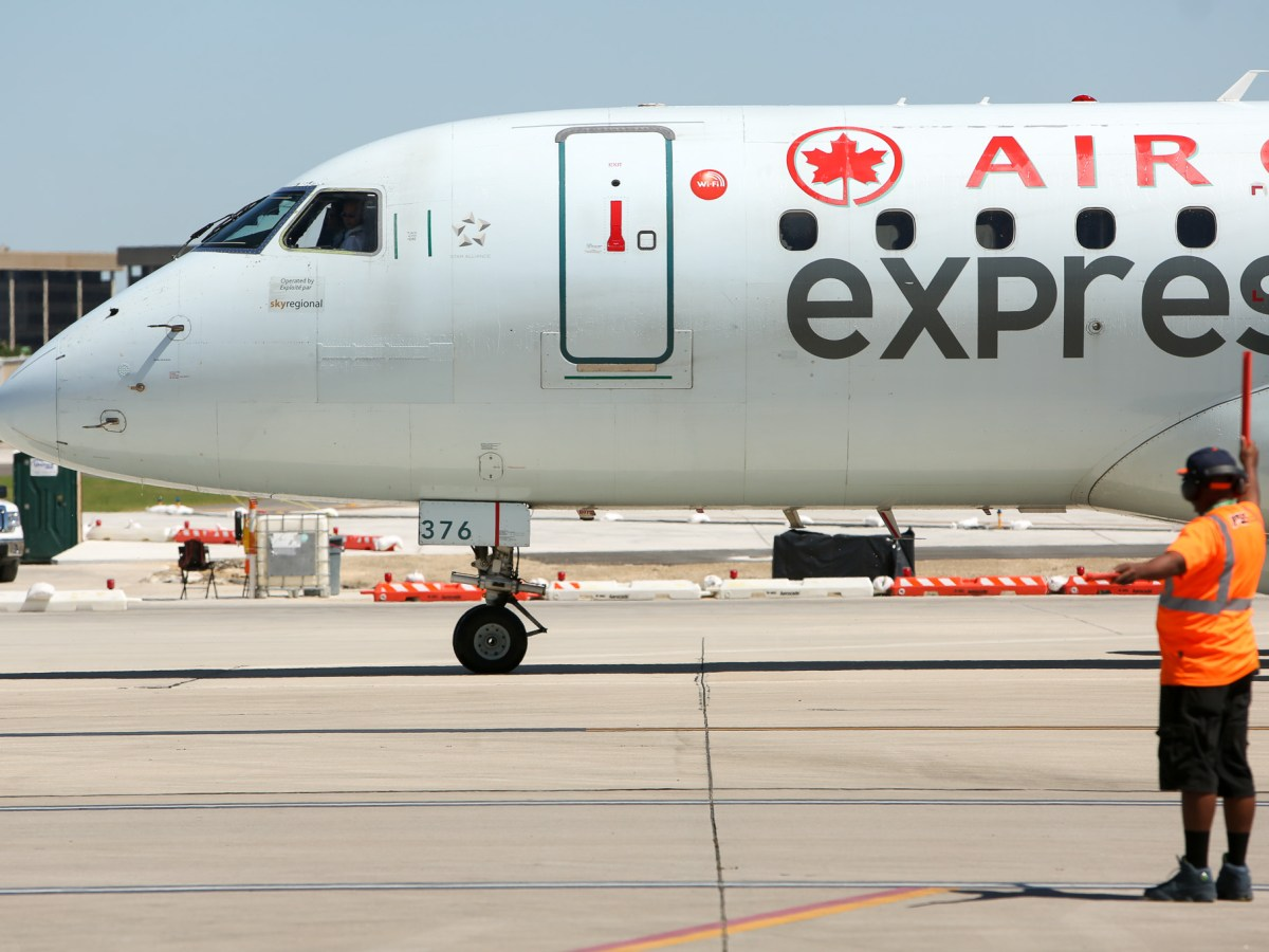 Air Canada Express Ebraer E190 arrives at the SAT terminal after it's first nonstop flight from Toronto.