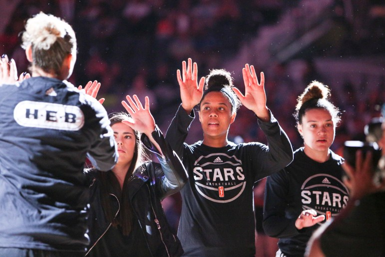 Nia Coffey high fives starting players for the San Antonio Stars as they are introduced.