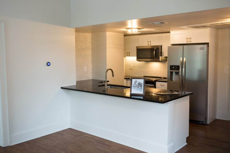 A kitchen in the one bedroom at Maverick Apartments.