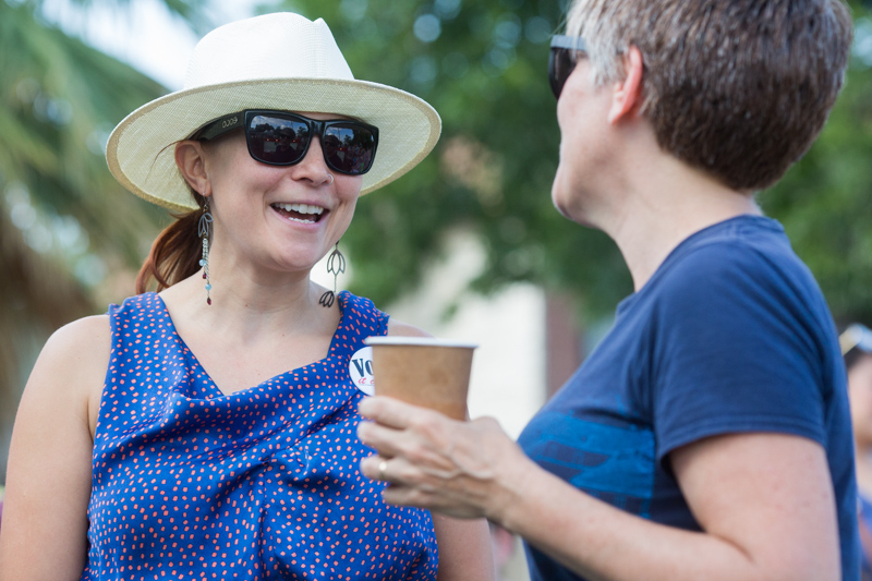 Jennifer Khoshbin talks with neighbors at her home during PorchFest 2017.