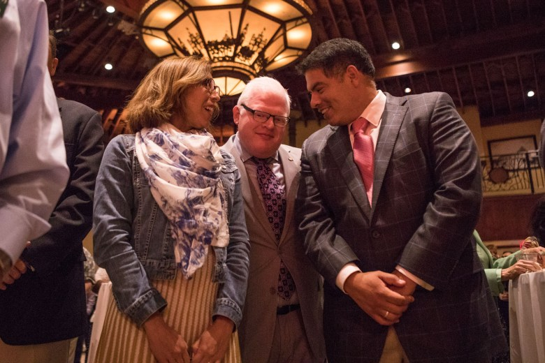(From left) Councilwoman Shirley Gonzales (D5), San Antonio Hispanic Chamber of Commerce Vice President of Government Affairs Leroy Cavazos Reyna, and Councilman Manny Peláez (D8) chat at the reception honoring San Antonio's 2017 City Council leadership at the Pearl Stable.