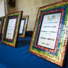 Awards are laid out in preparation for the Growth on the Eastside (SAGE) award ceremony.