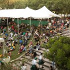 A large crowd gathers to watch Samba Vida dancers perform at the Texas Folklife Festival.
