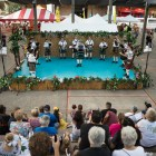 A crowd gathers to watch The San Antonio Pipes & Drums play on stage during the Texas Folklife Festival.