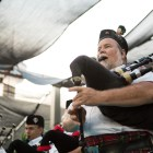 The San Antonio Pipes & Drums play on stage during the Texas Folklife Festival.