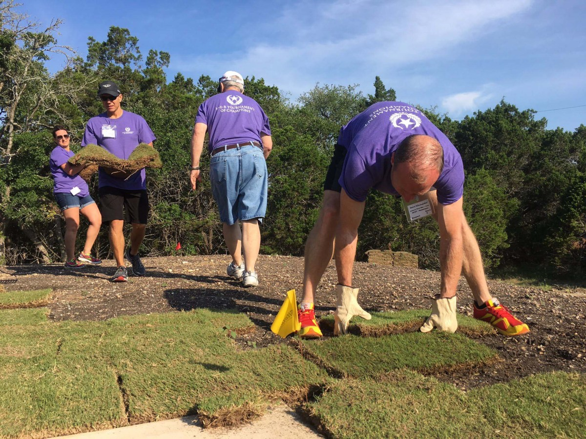 Volunteers work on landscaping at the Homes for Our Troops home site in New Braunfels, Texas.