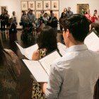 A community-centered choir performs From Those Who Follow The Echoes to a large audience at the McNay Art Museum.