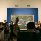 Luis Corpus conducts From Those Who Follow The Echoes at the McNay Art Museum.